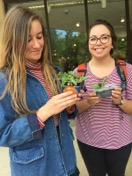 Image of students with plant starts